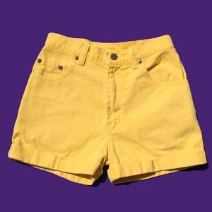 Vintage early 1990s yellow high waisted shorts